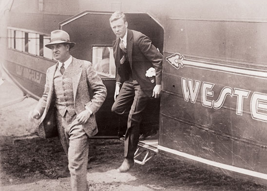Charles Lindbergh and Harry Guggenheim exiting an airplane