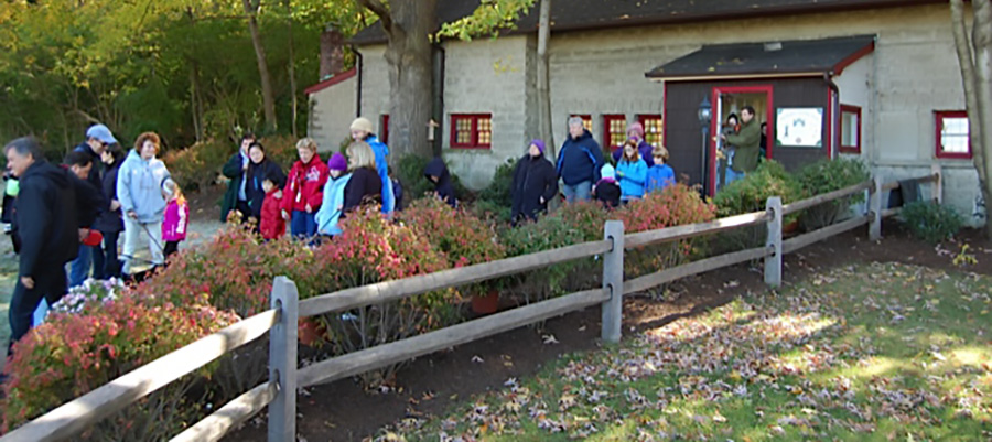 Visitors exit the Phil Dejana Learning Center & Outdoor Classroom