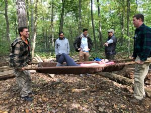 Wilderness Survival class - woman carried on stretcher