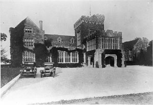Archival photo of Hempstead House - 1920s with cars