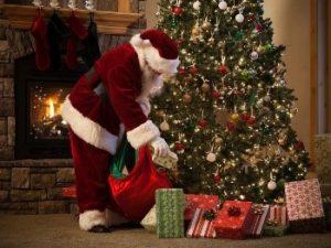 Christmas - Santa leaing gifts at a Christmas tree