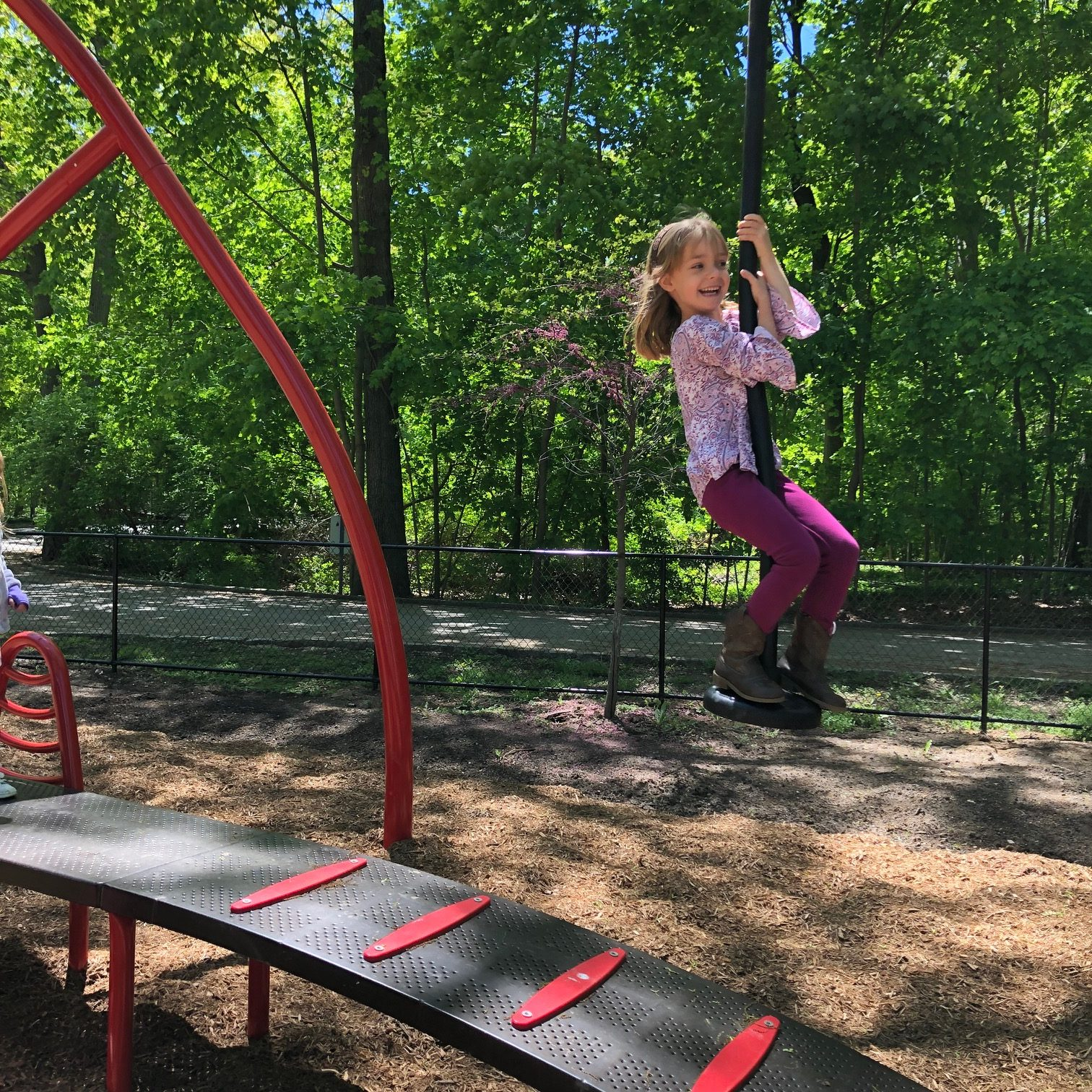 Girl on zip line in playground